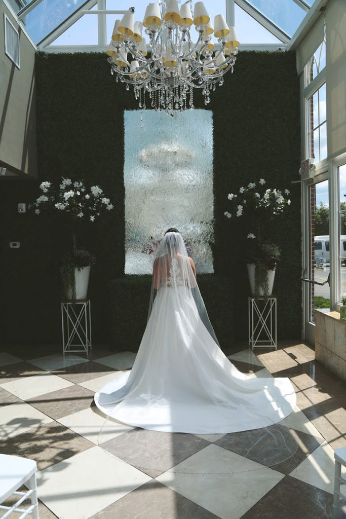 bride facing away with view of veil and flowing train at at 5120 Restaurant venue space